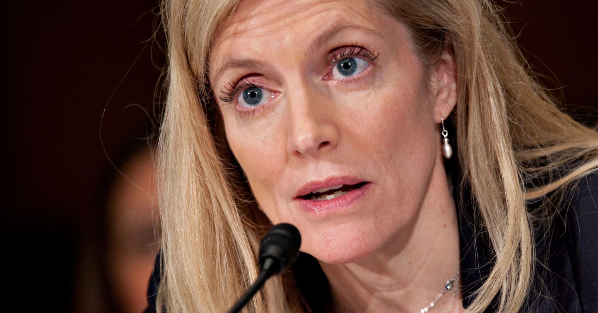 Fed Gov. Brainard sees 'downside risks' increasing, says balance sheet runoff should end this year